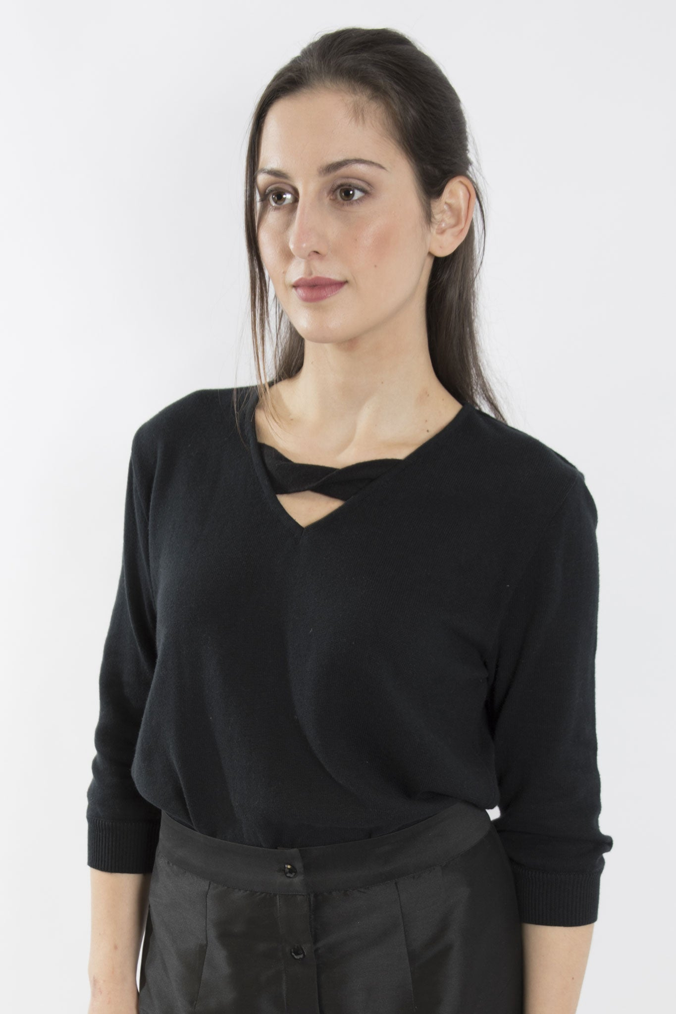 Sketch London black Contemporary V neck jumper with a chic twisted bow  detail. Sleeves are cropped ethical sustainable cotton