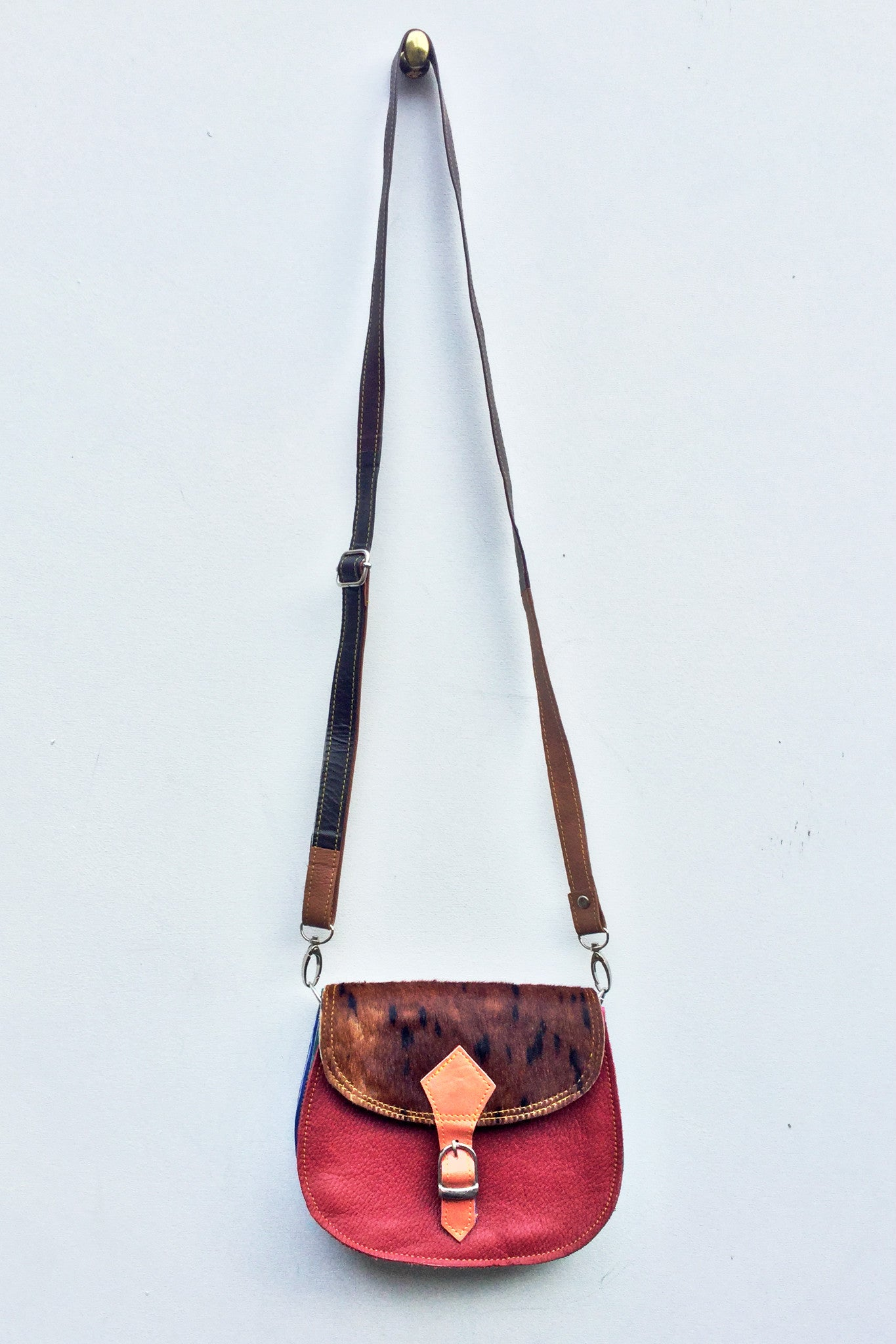 sketch london animal print saddle shape cross body bag red cherry pony print leather bag ethical sustainable