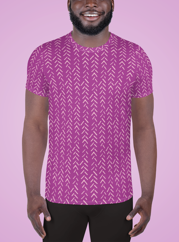 Smiling athletic black man wearing a purple active short-sleeve shirt with light pink mud cloth inspired design