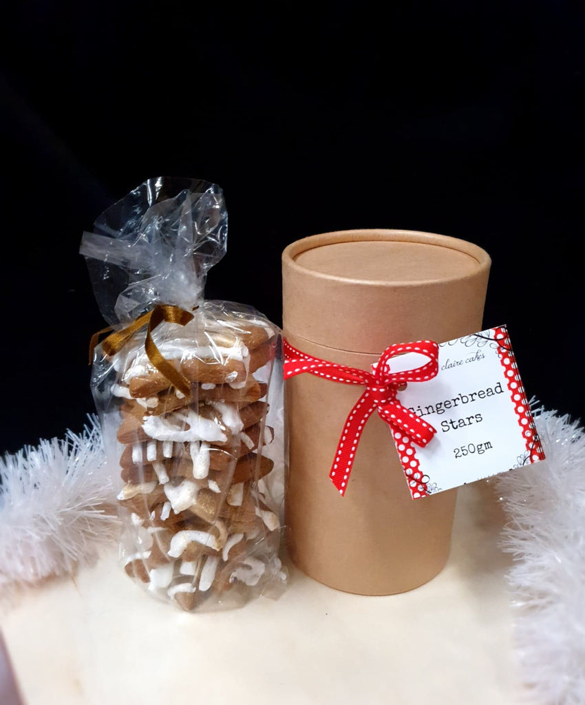 Gold-dusted Gingerbread stars in a gift cylinder