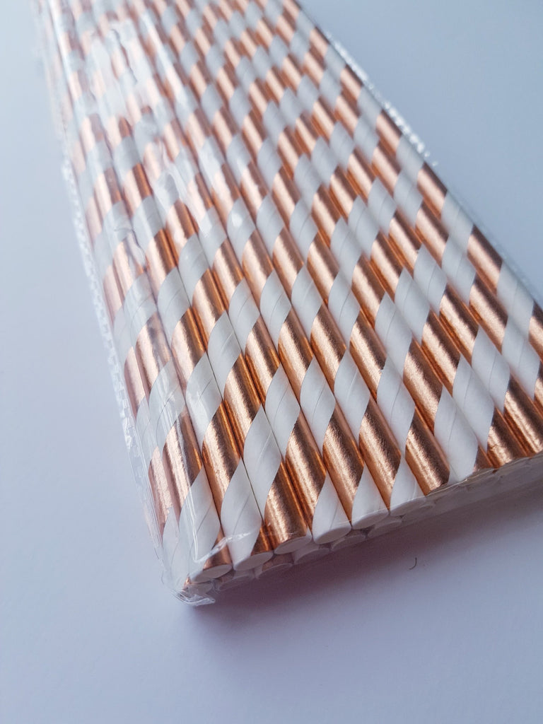 Rose gold and white striped straws