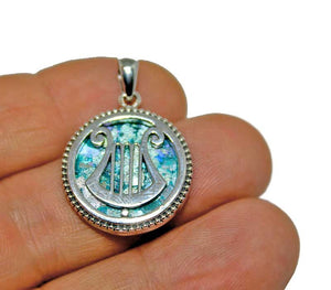 Silver round pendant with King David harp