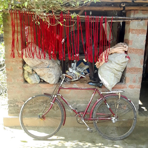 red bicycle, red thread