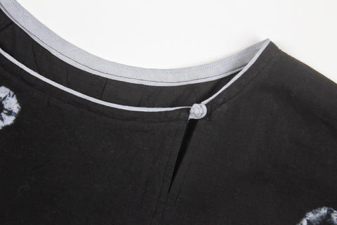 button knot at left side of neckline