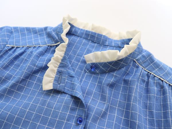 sew a blue shirt with white ruffled collar