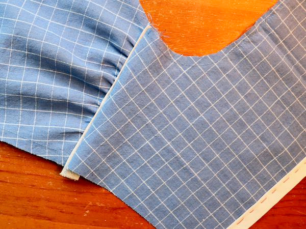 construction of blue shirt with white piping