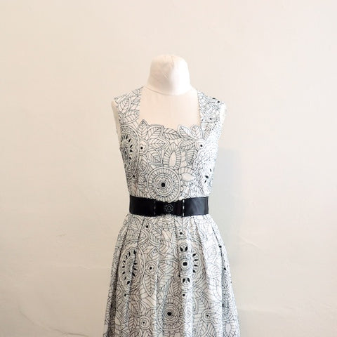 Embroidered dress with shaped neckline sewn by Loom and Stars