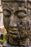 large buddha head cast concrete statue black wood texture gold gilt