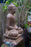 "36"" Buddha seated on lotus flower pedestal large lightweight resin statue side view"