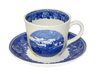 white tea cup with blue image of fort and saucer with blue rim