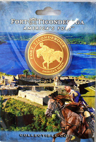 gold coin on card with image of fort and a soldier on a horse