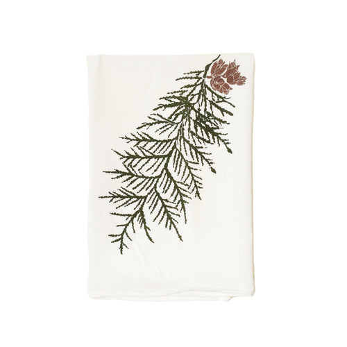 green cedar leaf with pine cones on natural canvas tea towl