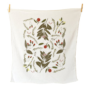 all over towel pattern of red berries and green evergreen leaves