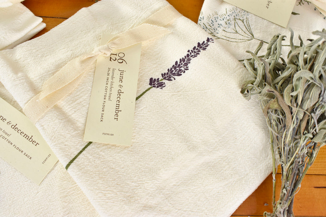 natural cream colored tea towel wrapped with tag and lavender design