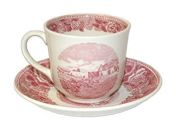 white and red teacup with fort image and saucer with red border