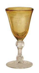 wine glass shape with yellow tinted cup and clear glass stem and base