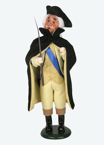 George Washington doll with hat, cap, and walking stick on white background