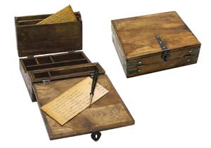 image of wooden writing desk opened with paper and pen