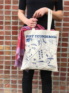 model holding natural canvas bag with navy blue map design