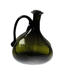 large green glass onion shaped bottle on white background