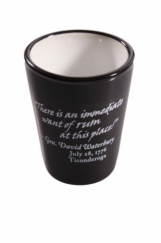 black shot glass with white text