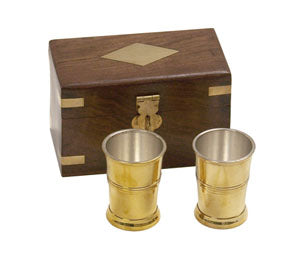 "the two brass cups are silver-plated on the inside to make the cups food safe. The 4"" wooden box has a brass inlay diamond on top with a brass latch."