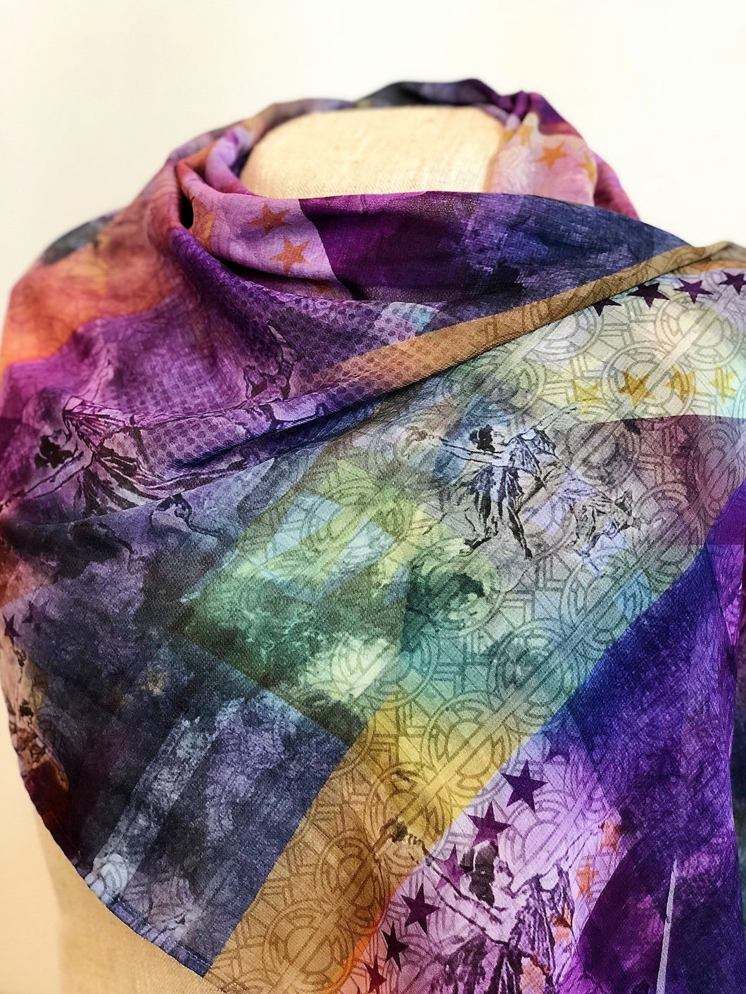 scarf wrapped around mannequin, colors of green, yellow, purple, and some white