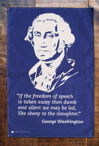 dark blue tea towel with image of George Washington and quote underneath