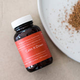 Bottle of Calm It Down herbal supplement from Julie Bear Don't Walk Apothecary — natural support for digestive issues