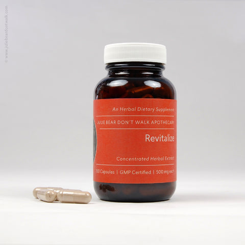 Bottle of Revitalize herbal supplement from Julie Bear Don't Walk Apothecary — natural support for fatigue, lack of vitality and edema
