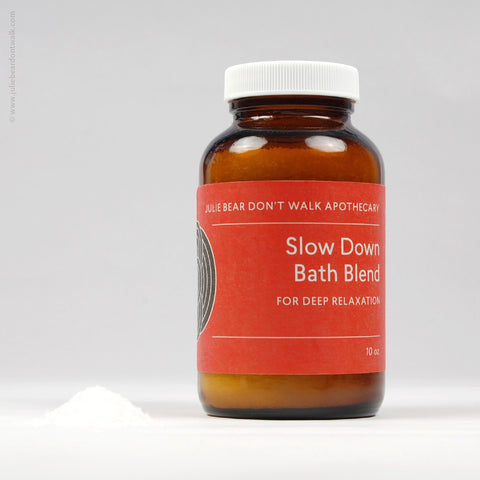 Bottle of Slow Down Bath Blend herbal formula from Julie Bear Don't Walk Apothecary — natural relief for stress and muscle tightness