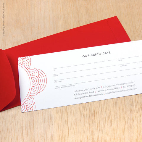 Paper gift certificate and red envelope from Julie Bear Don't Walk Apothecary