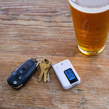 Load image into Gallery viewer, BACtrack Go Keychain Breathalyzer, Portable Keyring Breath Alcohol Tester, White