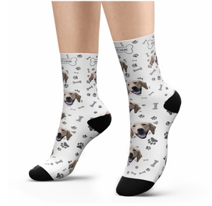 Feet with White Customized / Personalized socks printed with a dog head and bones.