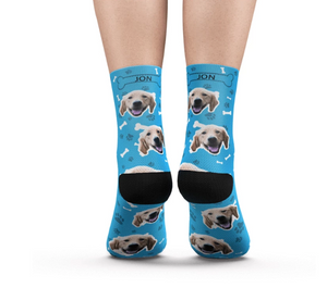 Feet with Blue Customized / Personalized socks printed with a dog head and bones.
