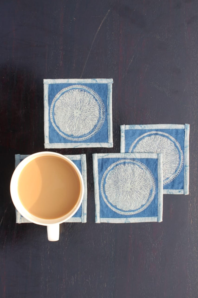 Indigo dyed and dabu printed coasters.(set of 4) - Aavaran Udaipur