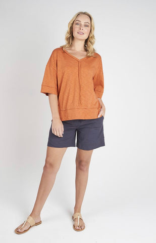 Torju Sun Glare V-Neck Tee in burnt orange organic cotton