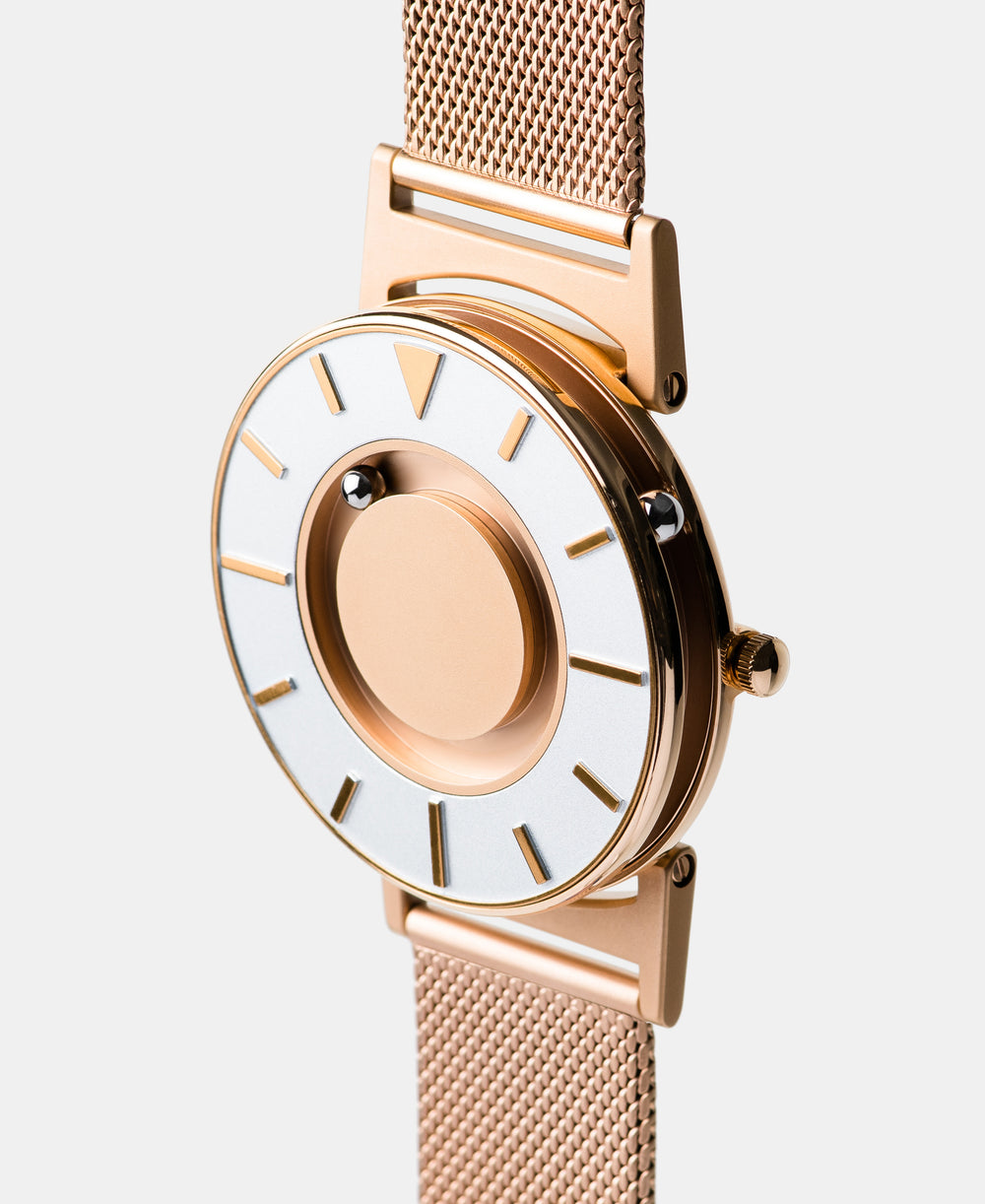 A photo of the watch from a side angle. The recessed track around the outside of the watch face is shown with the hour ball bearing in the track. The raised markers are noticeable from this perspective.