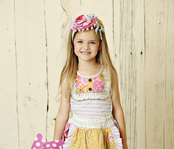 Girls striped sleeveless top with pastel ruffled bib