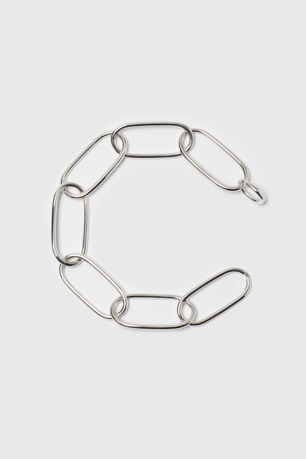 Statement bracelet made from bold link chains with a high gloss finish. Silver jewelry handmade in Berlin.