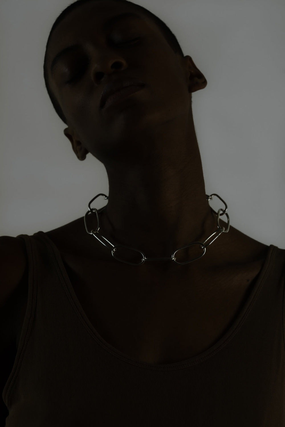 Statement neckpiece made from bold link chains with a high gloss finish. Silver jewelry handmade in Berlin.