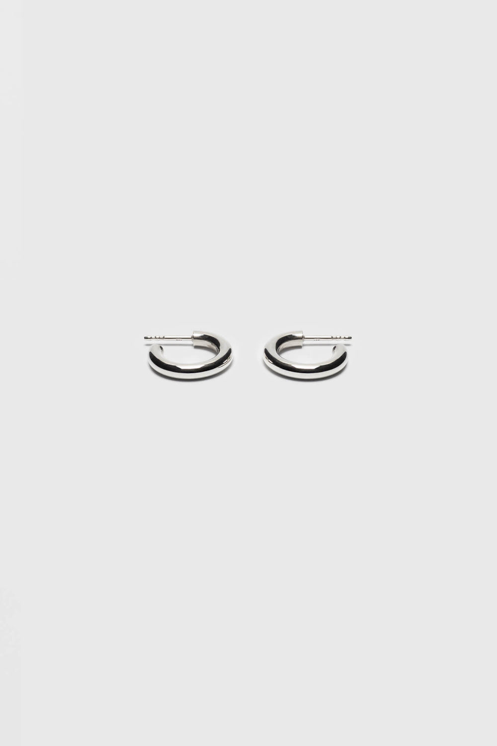 Small hoop earrings made of a bold silver wire. Fine jewelry handmade in Berlin.