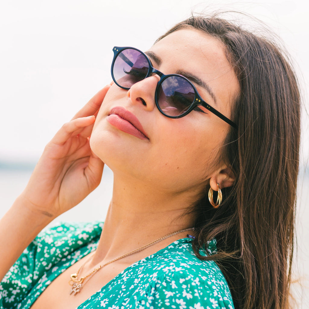 Woman wears Callula Co. petite sunglasses outside