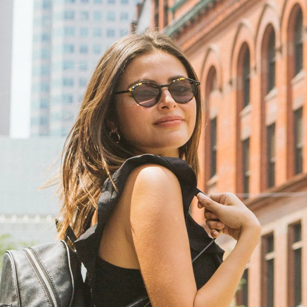 Woman wearing Callula Co. havana tortoise petite sunglasses