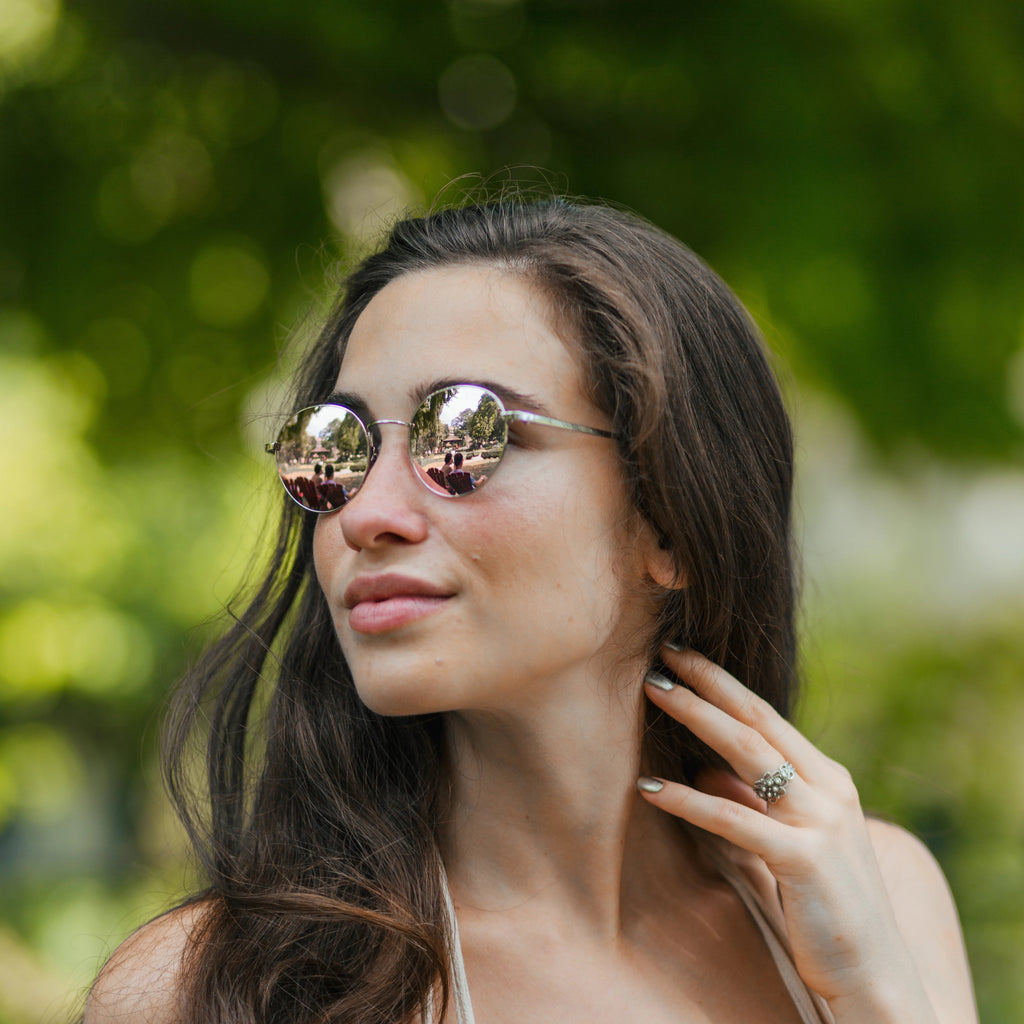 Woman wearing Callula Co. northern lights petite sunglasses