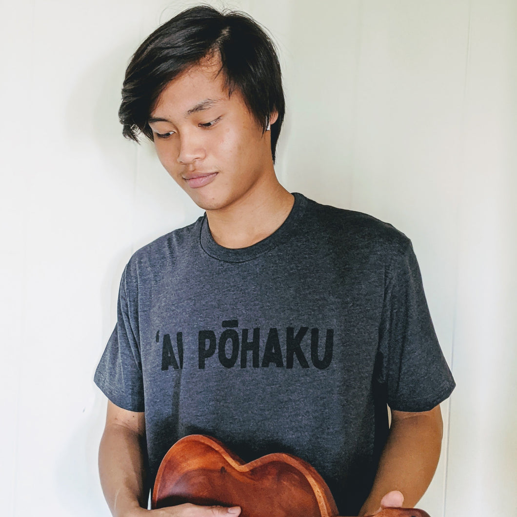 Soft lightweight heather charcoal men's tee with 'AI PŌHAKU  in black ink on the chest