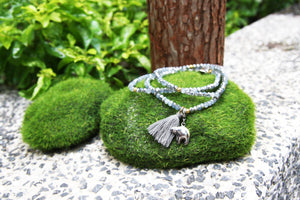 Crystal bracelet with tassel and silver bear charm