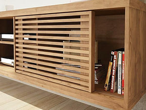 Tv Stand  It features a sliding door,