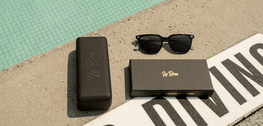 La Brea Grove Ash grey sunglasses by the pool