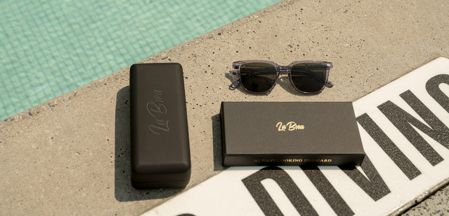 La Brea Grove Dusk clear sunglasses by the pool